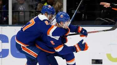Ryan Pulock of the Islanders celebrates his overtime