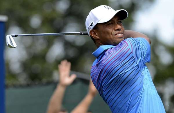 Tiger Woods hits his tee shot on the