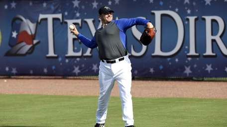 Roger Clemens throws during batting practice with the