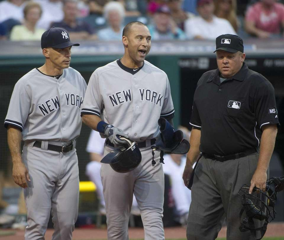 Yankees batter Derek Jeter, center, complains to home