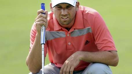 Sergio Garcia lines up a putt on the