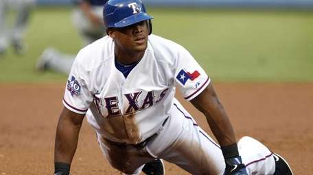 Adrian Beltre slides safely into third base on