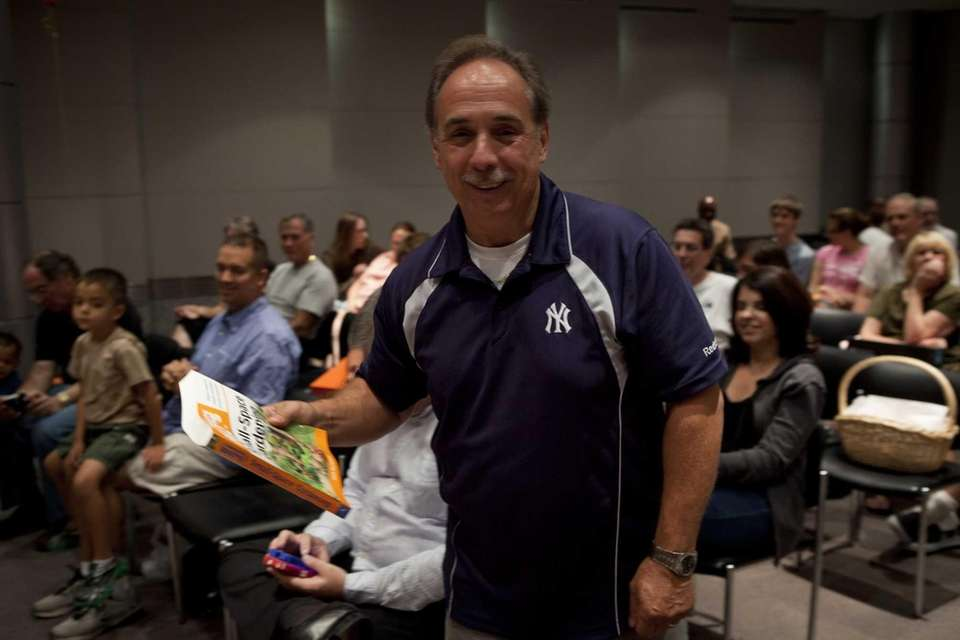Steve Sicarella shows off his prize as one