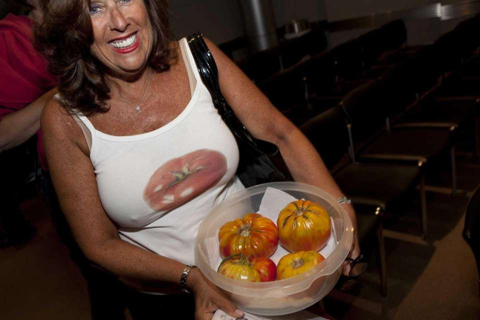 Janet Hart shows off her tomatoes as she