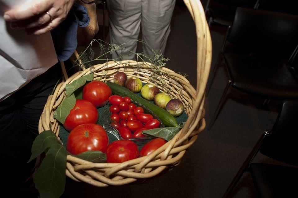 Santo Endrizzi carries his bountiful basket of tomatoes