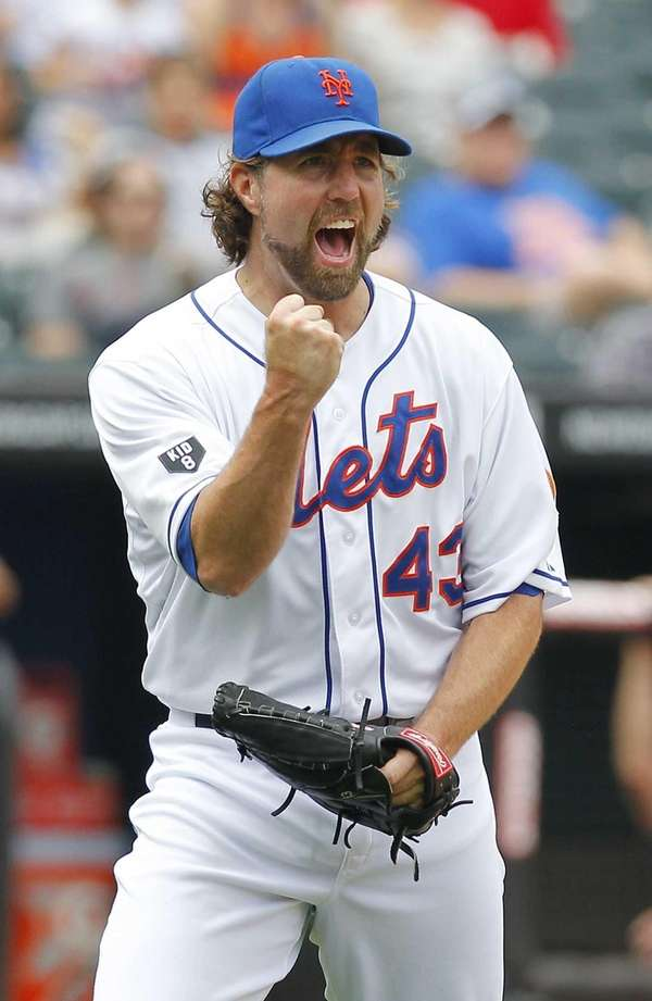 Mets pitcher R.A. Dickey reacts to a double
