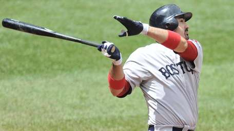 Boston's Adrian Gonzalez hits a two-run home run