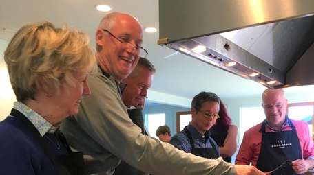 A cooking class whips up a dish at