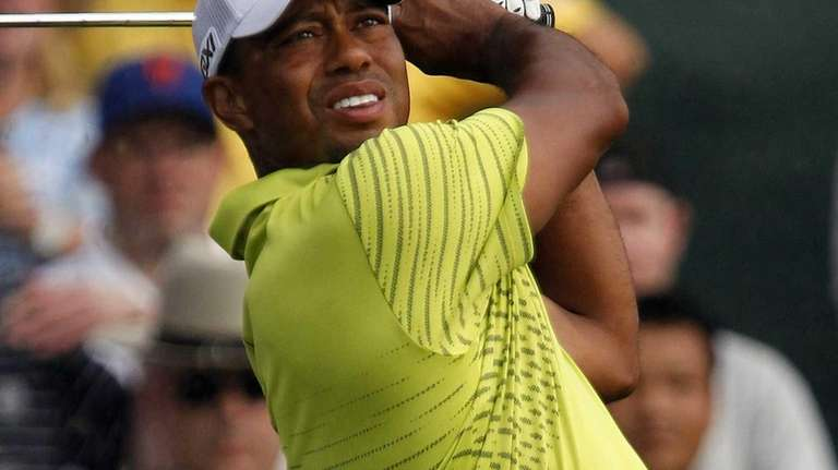 Tiger Woods hits a tee shot on the