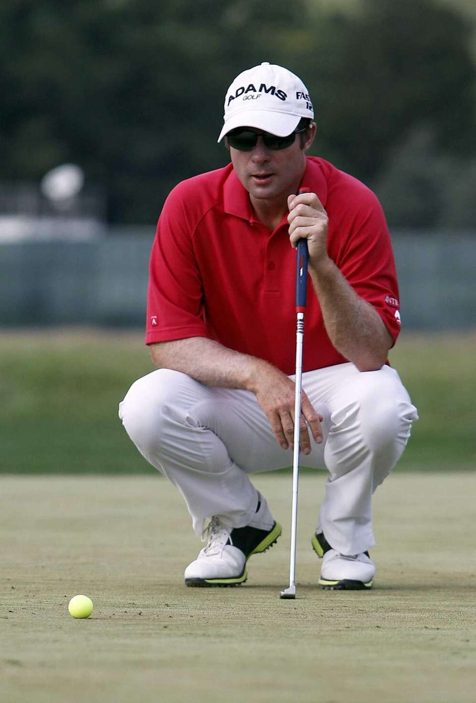 Gary Christian lines up his putt on the