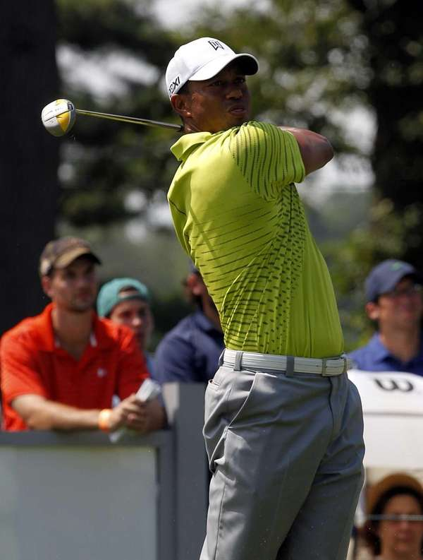 Tiger Woods tees off at the second hole
