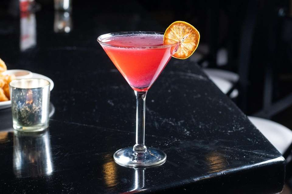 A tart hibiscus martini, made with Monkey 47