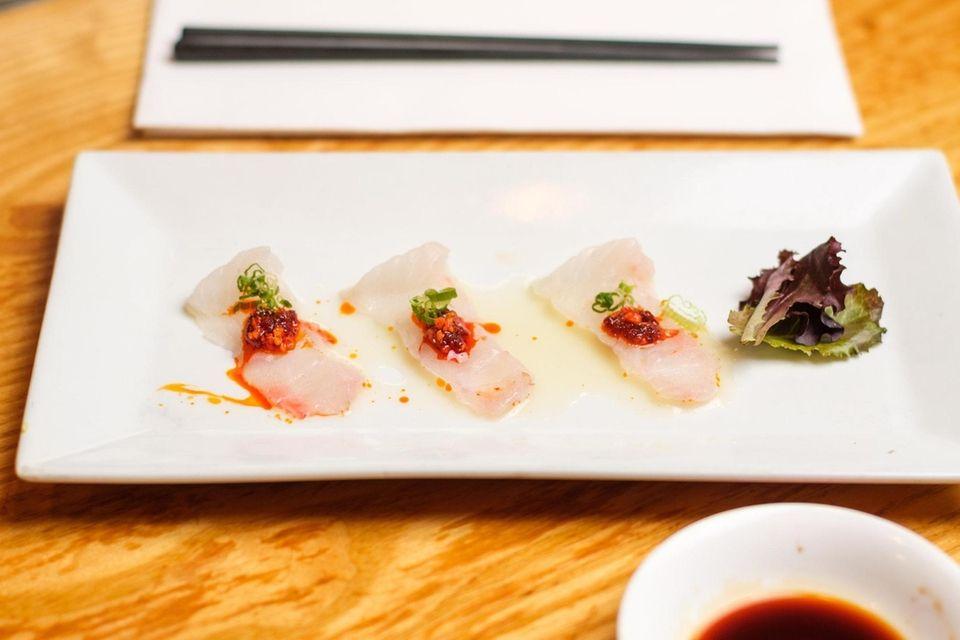 Fluke sashimi is topped with yuzu kosho (pepper