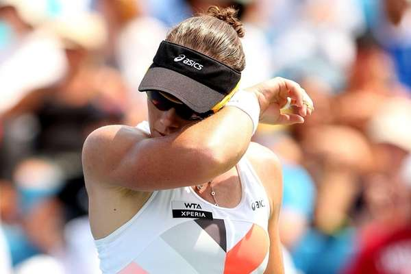 Samantha Stosur of Australia wipes her face between