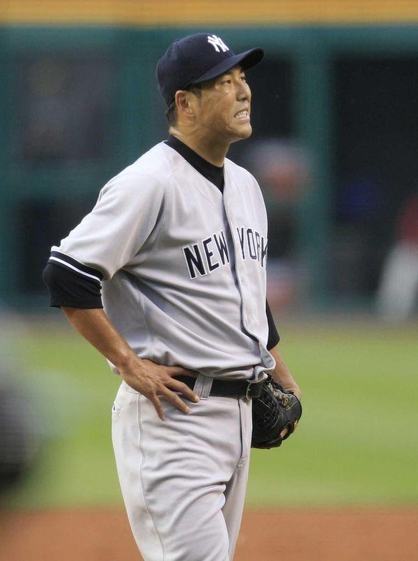 Hiroki Kuroda reacts after a three-run home run