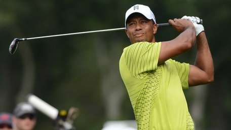 Tiger Woods watches his drive on the 12th
