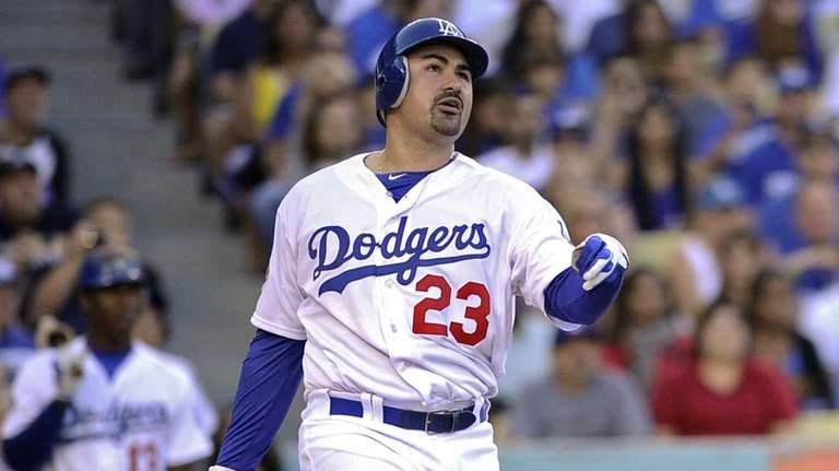 Adrian Gonzalez watches his three-run home run during