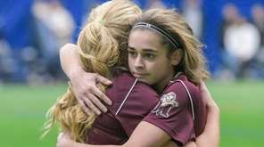 Molloy's Lexi Verni, right, hugs a teammate following