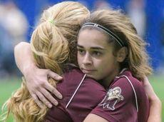 Molloy's Lexi Verni, right, hugs a teammate following