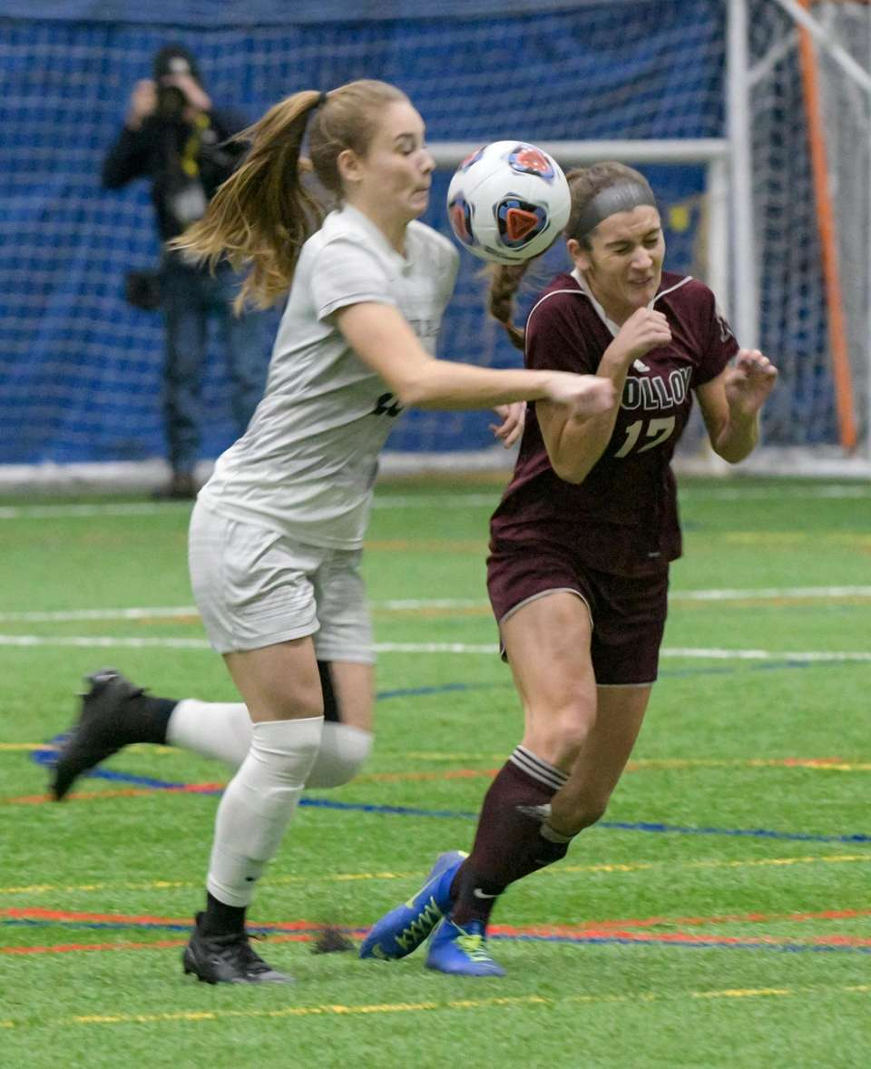 Molloy's Sabrina Bell, right, heads the ball as