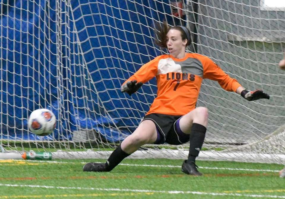 The ball gets past Molloy's Jacki Carty for