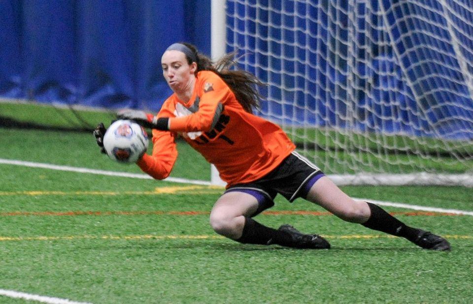 Molloy's Jackie Carty stops a Saint Rose shot