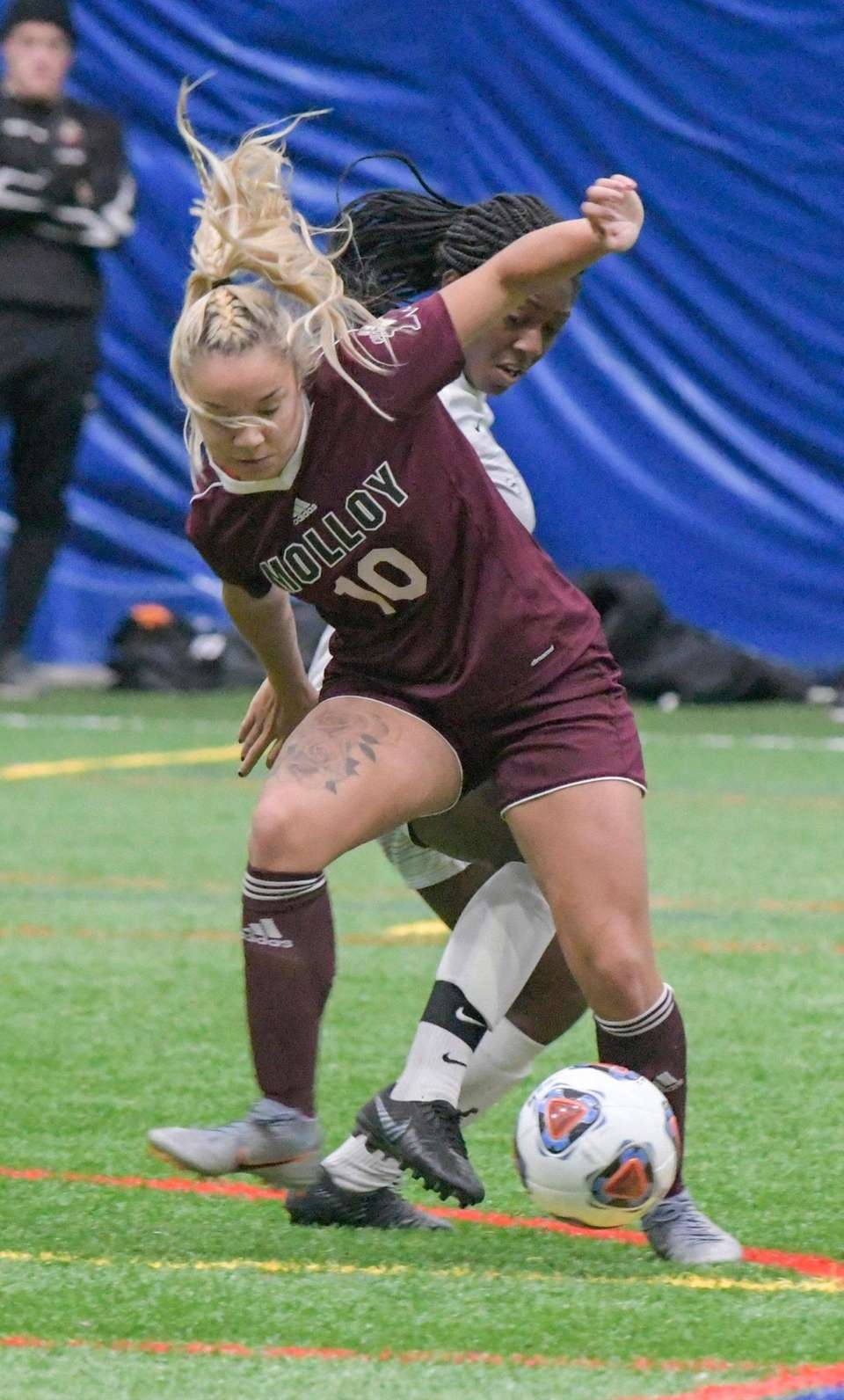 Molloy's Dana Poetzsch takes the ball away from