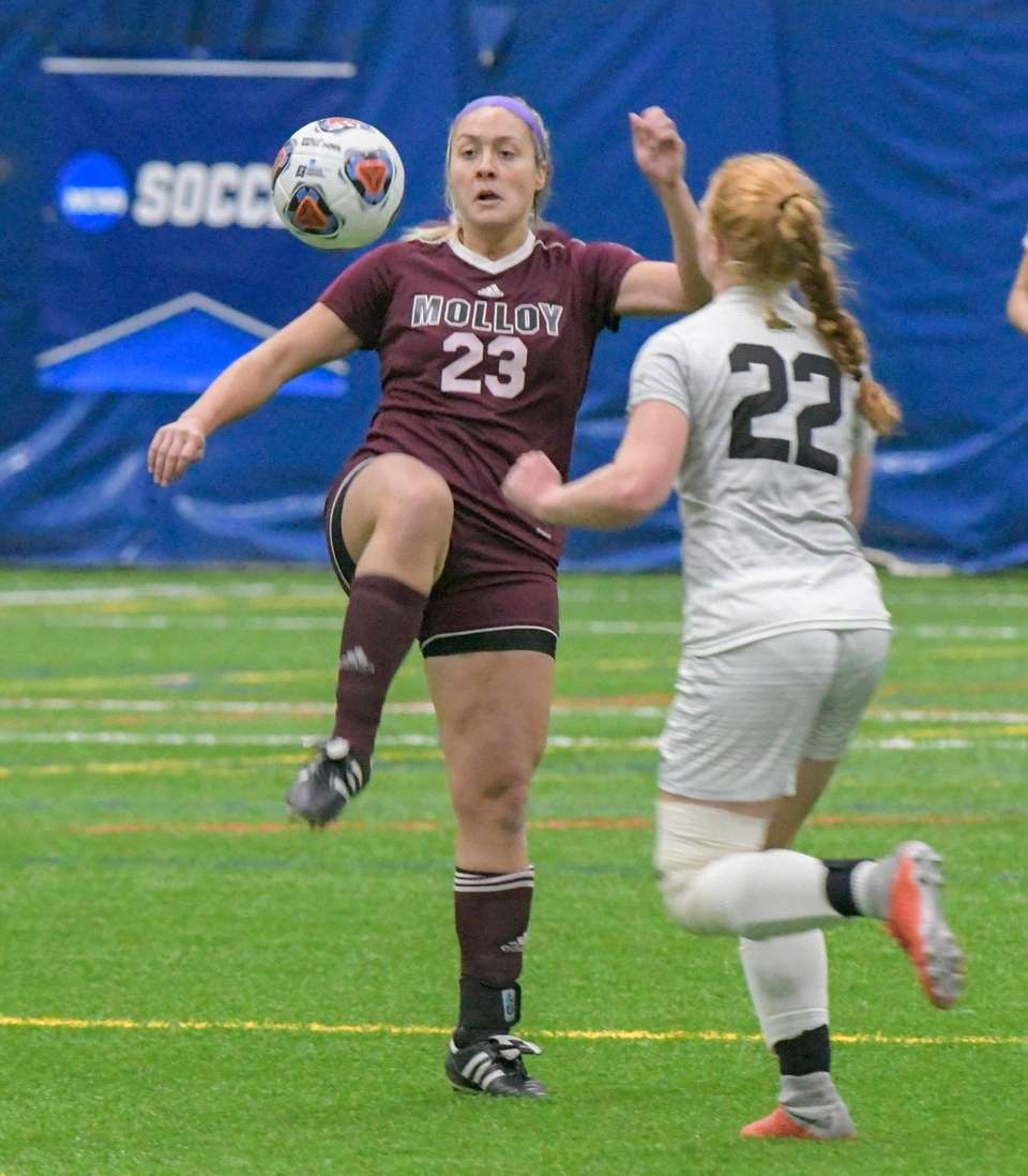 Molloy's Kelsie Moinzadeh, left, controls the ball as