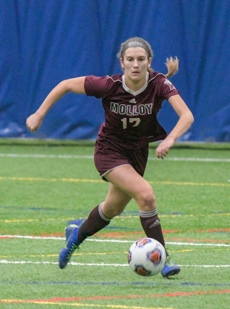 Molloy's Sabrina Bell, takes the ball down the