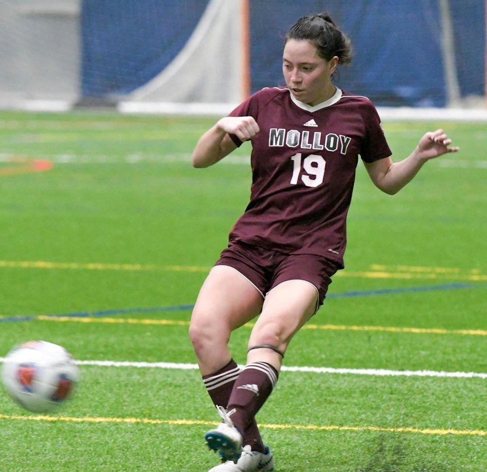 Molloy's Carli Fonesca kicks the ball down the