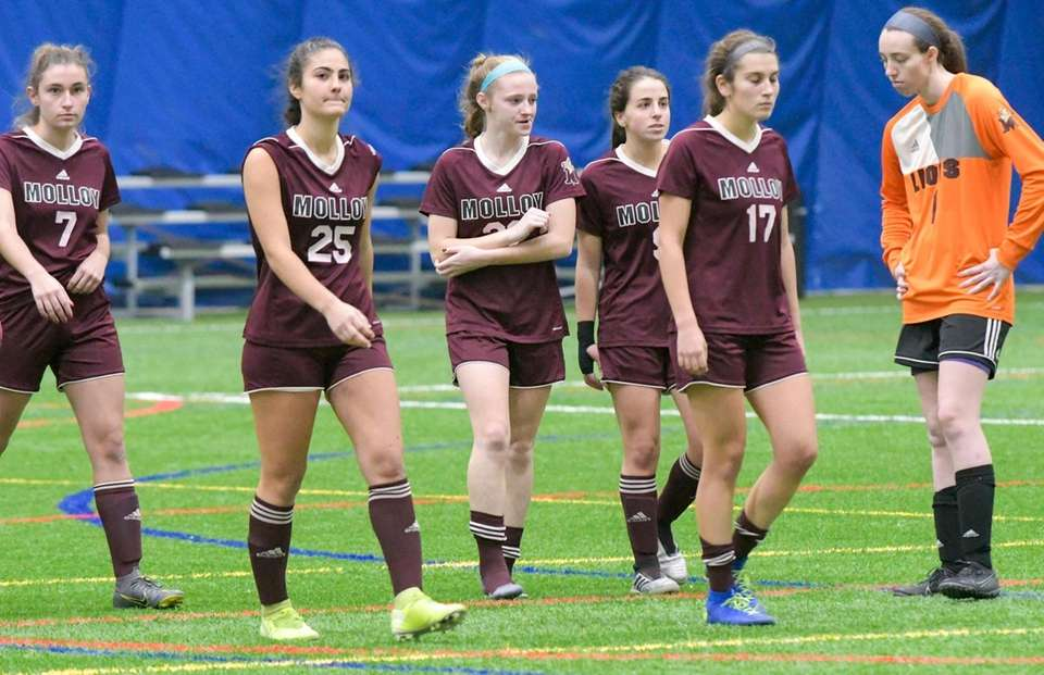 Molloy players react to their 4-1 loss to