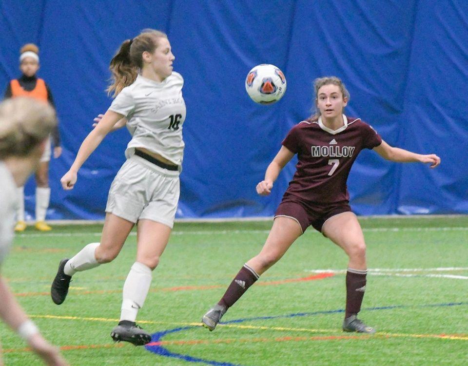 Molloy's Joanna Mauceri, right, centers the ball as