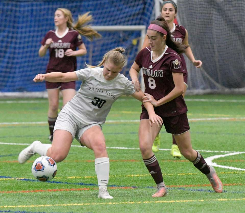 Molloy's Sarah Tappeto, right, tries to hold back