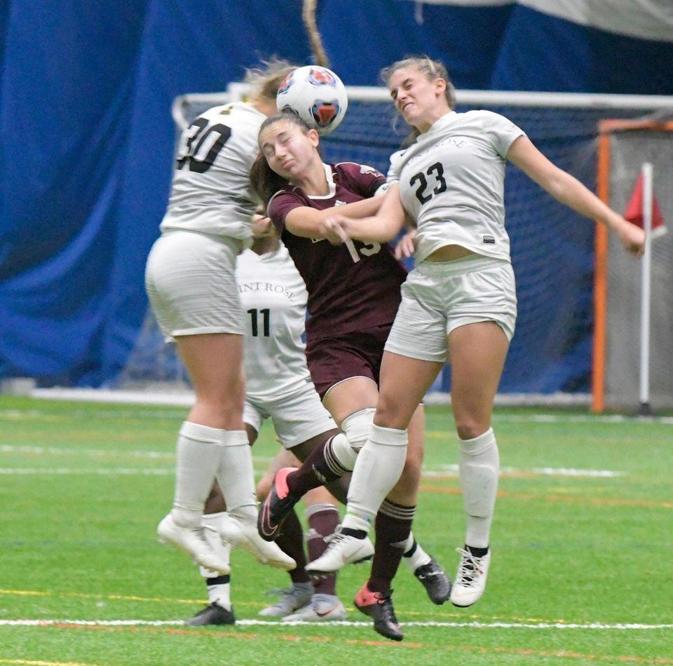 Molloy's Angela Careddu, center, heads the ball between