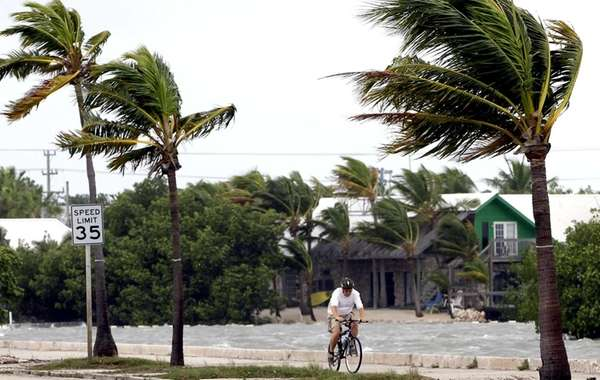 A cyclist rides in Key West, Fla., as