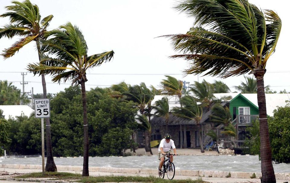 A cyclist rides in Key West, Fla., as