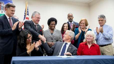 Suffolk County Executive Steve Bellone shakes hands with
