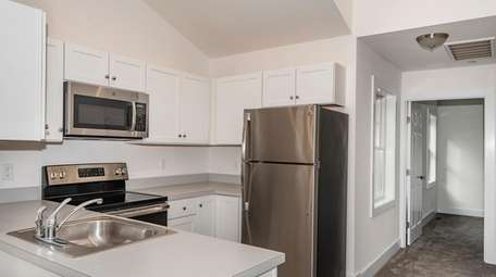 The kitchen of a one-bedroom condominium unit, which