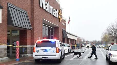 Police respond to the Walmart store on Crooked