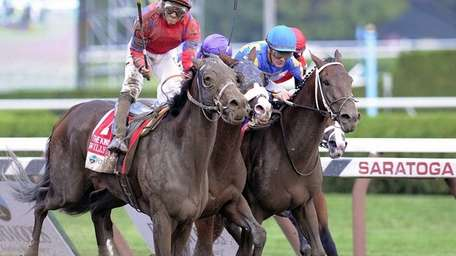 Willy Beamin. left, with Alan Garcia aboard, wins