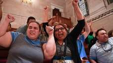 Spectators celebrate after the Green Light Bill, which