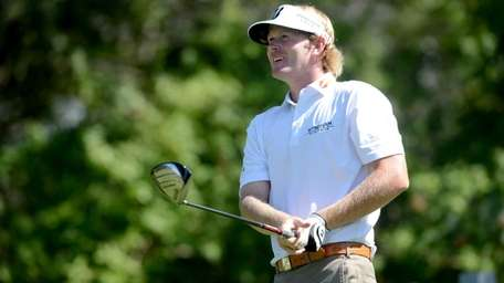 Brandt Snedeker watches his drive on the seventh