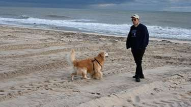 Richard DeRose of Wainscott walks his dog Thursday