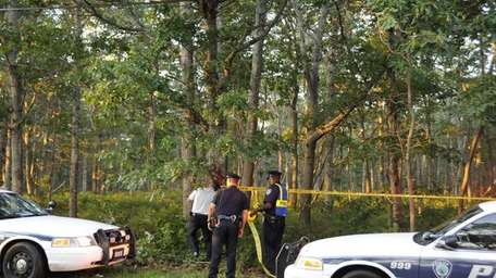 East Hampton Town Police secure the scene on