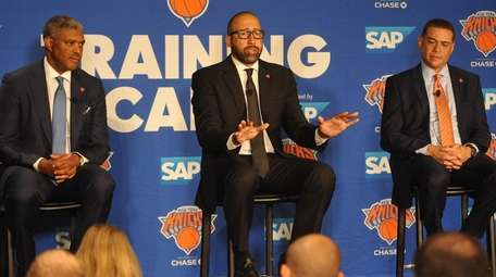 David Fizdale, center, speaks with the media during