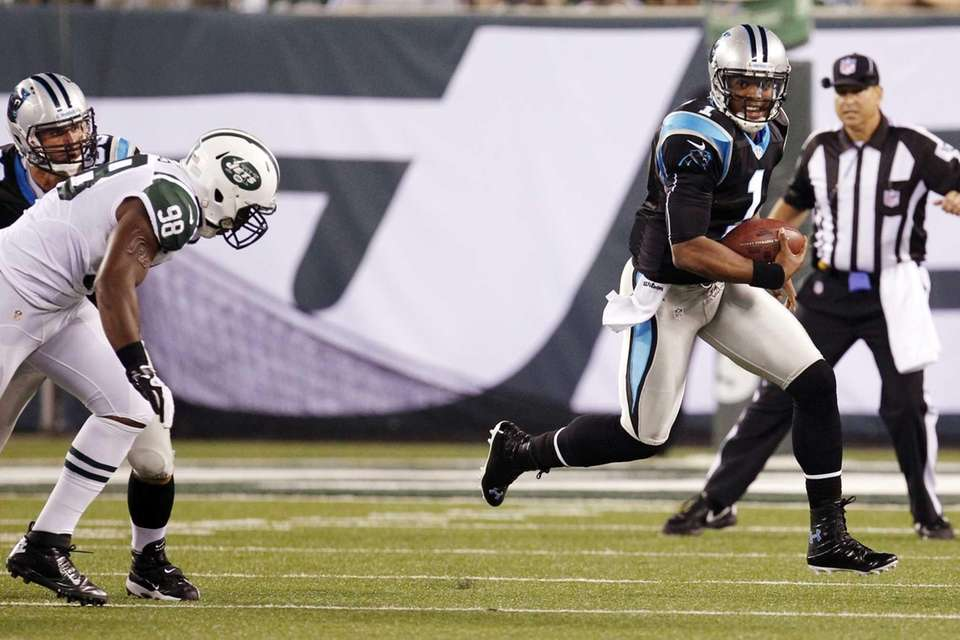 Carolina Panthers quarterback Cam Newton (1) scrambles away