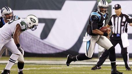 Carolina Panthers quarterback Cam Newton (1) scrambles away