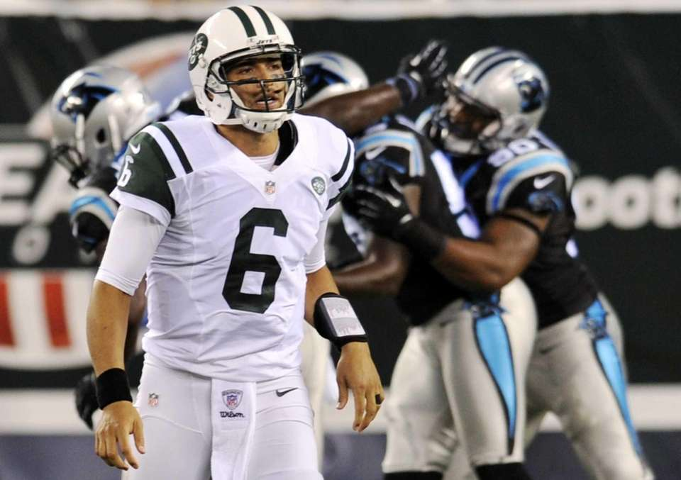 New York Jets quarterback Mark Sanchez (6) reacts