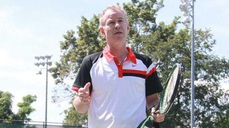 John McEnroe announces the opening of the John