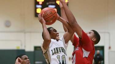 Longwood's Jeremiah Mobley (10) goes to the basket
